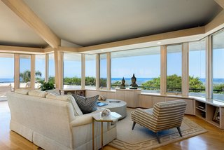 Walls of glass provide uninterrupted views of the mountains and coast.