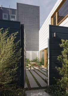 The garden courtyard is the first space the owners experience when entering from the street.