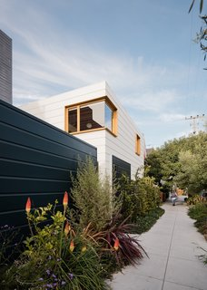 """""""While the house enjoys its inner garden and cloister-like character, a major aim of the project was to give back to the neighborhood through the creation of a public green space along the property line,"""" says Ryan. """"To do so, large sections of the sidewalk around the house were removed and converted to lush planting beds, which the owners tend."""""""