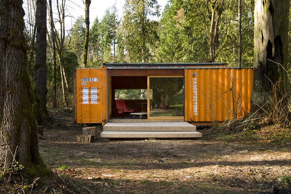 """Known as the """"project that kicked off Cargotecture,"""" Hybrid's Studio 320 was fabricated in 2004 and delivered to Enumclaw, Washington. The interior is lined in reclaimed plywood formerly used on the bleachers of a local high school gym."""