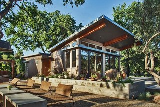 Manufactured in Utah and installed on site in six weeks, this 1,100-square-foot Stillwater prefab home was craned into place over an existing barn in Napa, California.