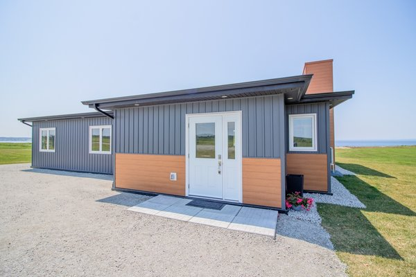 Saulnier and German built the Recycled House on 1.46 acres of oceanfront property on family land in Meteghan River, Nova Scotia.