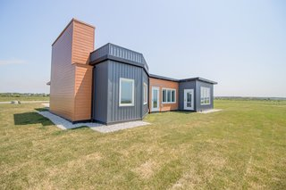 JD Composites clad the exterior with aluminum and vinyl siding for looks, however the composite prefab panels could have been simply coated with stucco.