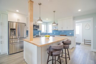 The modern interior design and finishes are by interior designer Mackenzie Waterman.