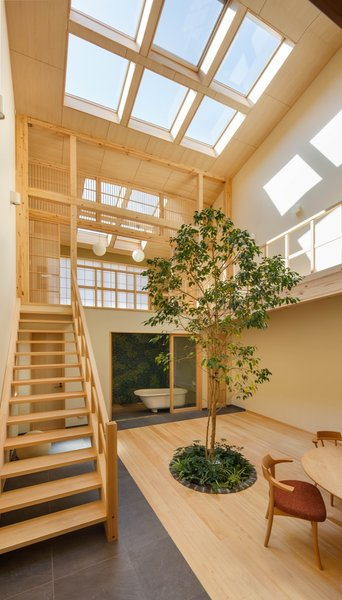 Since the house is edged in by homes on the east, west, and south sides, the architect punctuated the gabled roof with large skylights to bring daylight into the home.