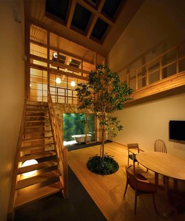 The House in Kyoto illuminated with select lighting at night.
