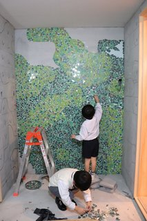 The clients' two sons helped assemble the mosaic tile for the bathroom walls.