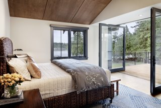 Large operable walls of glass open the master bedroom up to an outdoor deck. The client's bed is equipped with casters to allow it to roll in and out onto the deck.