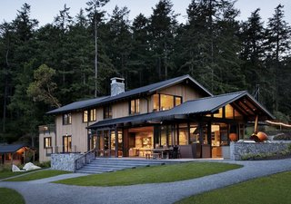 """The choice of materials was made to fit the palette of the landscape and evoke the traditional farmhouses and cabins of the islands, but with a modern take that fits the freshness of the clients and that would serve them for generations to come,"" explain the architects, who clad the buildings with stained clear Western Red cedar siding as well as wood salvaged from snow fences and old barns. Natural stone quarried and fabricated in British Columbia grounds the main house."