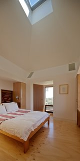 Housed inside the kiln is a bedroom with an operable skylight that serves as a thermal chimney for passive cooling.