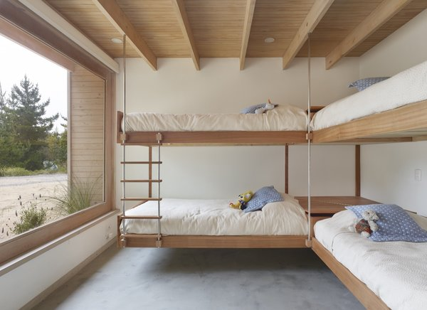The four bedrooms have different sleeping configurations and enough space to accommodate friends and extended family. The bed frames are made from rauli timber.