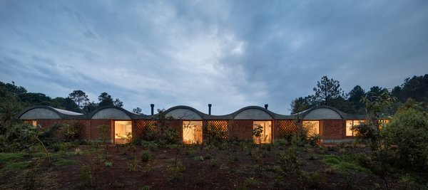 "The barrel-vaulted roofs that top the bedroom wing and the living areas help collect rainwater into the underground cistern and ""create a new topography."""