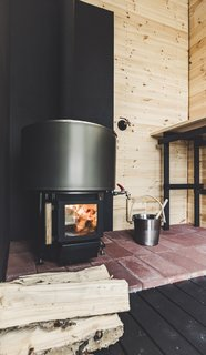 Brick and metal sheeting around the sauna stove provide fire protection.
