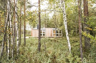 """Exterior, Wood Siding Material, Shed RoofLine, Metal Roof Material, and Cabin Building Type Located in Lavia in southwest Finland with nary a neighbor in sight, the remote cabin is set close to a lake and surrounded by a swamp and an old forest. The site was selected for its lake views and close connection to nature. """"On some days you can see moose, deer, and traces of lynx,"""" say the designers, who use the cabin as a retreat from city life."""