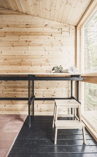 Bath Room, Medium Hardwood Floor, and Wood Counter The designers wanted to use recyclable materials throughout the cabin to minimize its environmental footprint. They constructed the benchtops in the sauna (pictured here) and the kitchen, as well as the bedroom cabinetry.