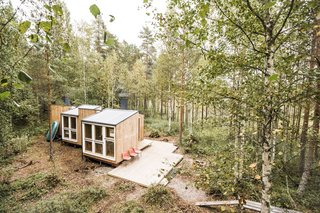 In Finland, two students with little experience but a lot of gumption design a minimalist home in the woods and build most of it—from the roofing to the stovepipes—on their own.