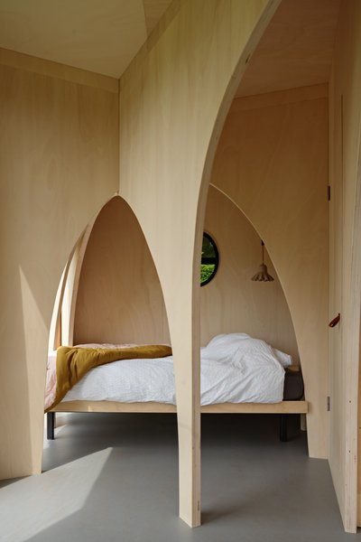 "The cabin structure and arches are made of locally sourced poplar plywood. The design team selected this material because of its fast-growing characteristics and wide availability in the Netherlands. ""Because they grow fast, there is a lot of water in the tree,"" add the architects. ""During drying, this water is replaced by air—that's why this wood insulates, and therefore feels warm and pleasant (it is the same wood type used for making clogs). The wood does not splinter, and it is non-toxic."""