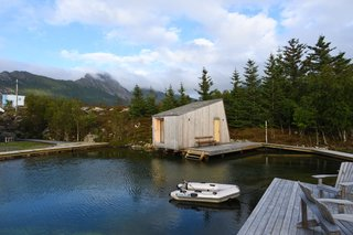 A new sauna and relaxation area were built using leftover materials from the first building phase. The sauna was made entirely of leftover cross-laminated timber, a reclaimed window from the restoration of the main house, and is topped with reclaimed slate roof tiles.