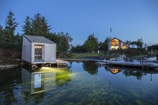 In addition to the new cabins and a sauna, the designers revamped old farmland to provide local produce to the restaurant, added landscaping around the seawater pond, and strengthened an existing quay to give fishing boats a place to dock.