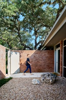 The architects did away with the open-air approach to the front door to create an indoor entry hall for more room to receive guests.
