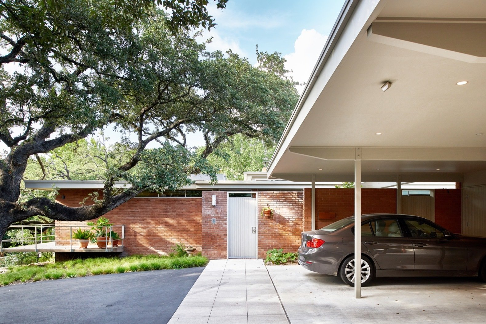 Balcones Residence by Clayton & Little Architects entrance and carport