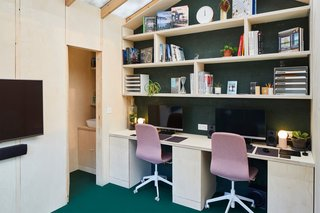 The compact 130-square-foot office interior offers enough space for two to three people. The insulated floors are lined with Monckton Green vinyl by The Colour Flooring Company.