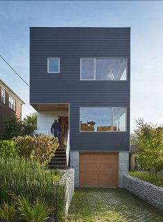 Factory built in just four days, this three-bedroom home minimizes its environmental footprint with rooftop solar panels, rainwater collection, edible landscaping, double-pane windows, and Energy Star–rated appliances.