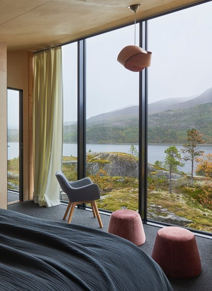 The master bedroom features spectacular views of the fjord.