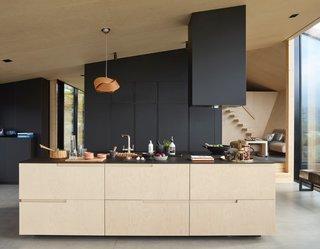 Birch veneer wraps the interior of the minimalist home, lending a sense of warmth.