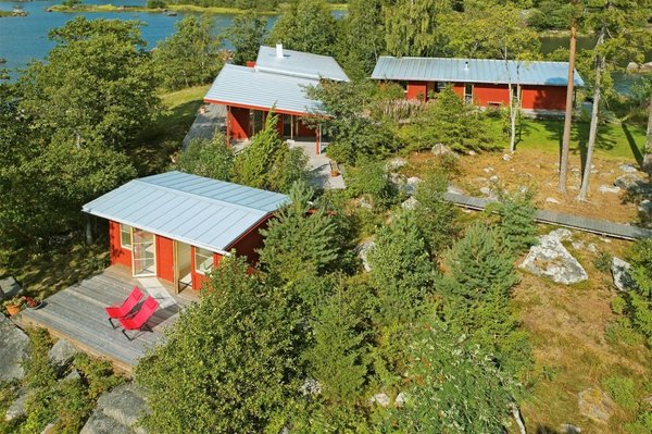 Off to the side of the main house is a compact beach house with two bunk rooms and a wooden deck.