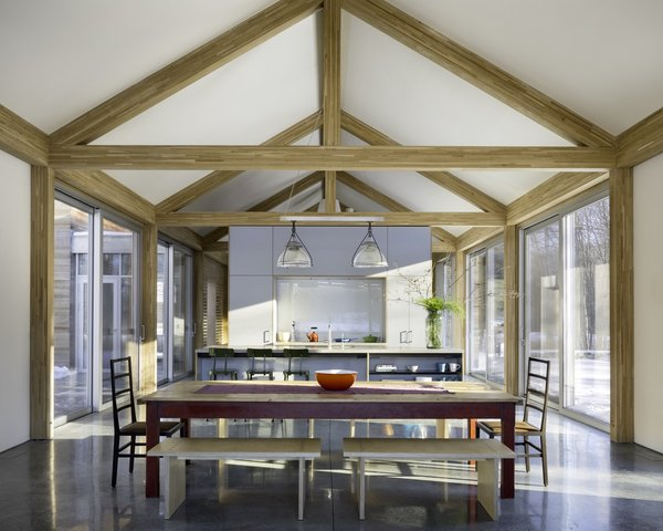 The white oak heavy timber framing is left exposed for dramatic effect in the open-plan great room. A minimalist palette of natural materials creates a soothing environment.