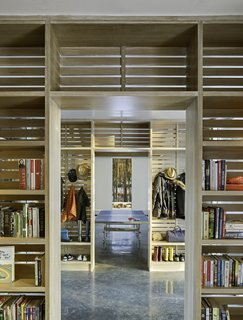 The view of the vestibule from the bedroom wing. On this side, shelving is installed for books, coats, and shoes.