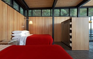 To lend a sense of warmth and for privacy, the architects wrapped the bedroom area with walls of tongue-and-groove vertical grain Douglas fir that matches the ceiling.