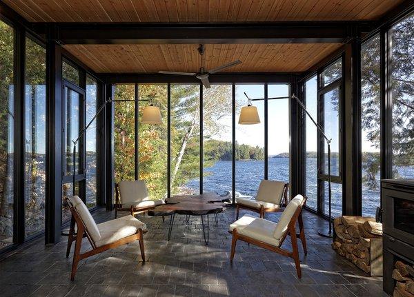 Glass Walls Wrap a Prefab Boathouse on a Remote Ontario Lake