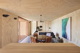 "Unpainted plywood wraps all around the living areas to give the interior ""a warmth and texture that interacts beautifully with the external Blackbutt timber,"" says Jackson. ""It has a robust , durable, and tactile quality that sits well with the internal concrete floors."""