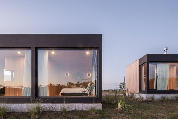 Two Wood-Clad Prefab Holiday Homes Connect to the Landscape of Rural Uruguay