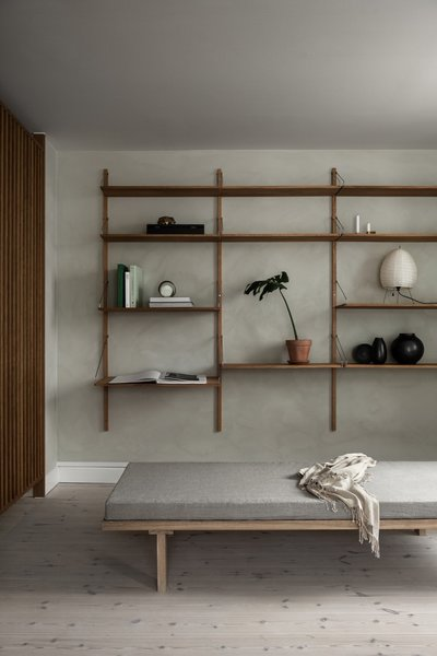 The daybed and shelf library are available in Frama's Permanent Collection.