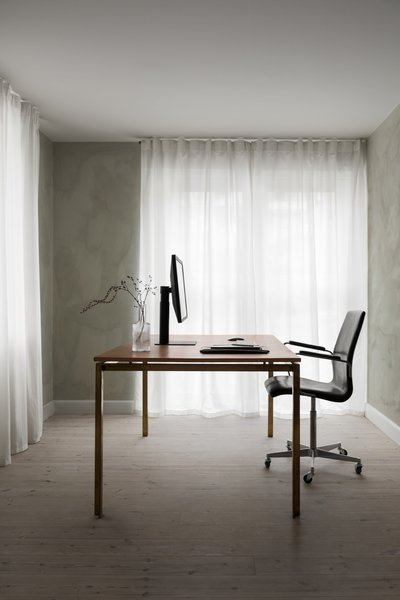 A peek at the office space with a Frama-designed leather-and-brass desk. The ground floor also houses the kitchen, dining area, and living room.