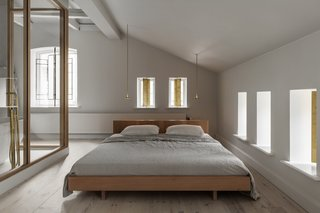 Frama built this custom bed frame from white-oiled Douglas fir. The hanging beside lights are by Giopato & Coombes.