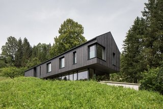 A Silvery Gabled Home Cantilevers Out Amid the Austrian Alps