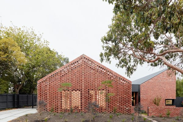 Recycled Red Brick Wraps Two Affordable Rental Homes in Australia