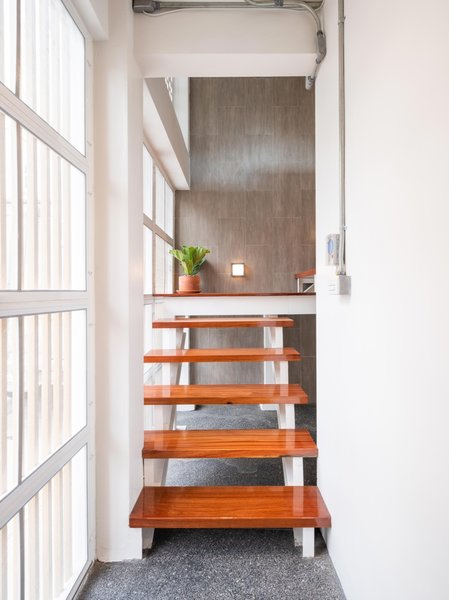 The architects used Makha wood, a timber local to Thailand, for the stair treads.