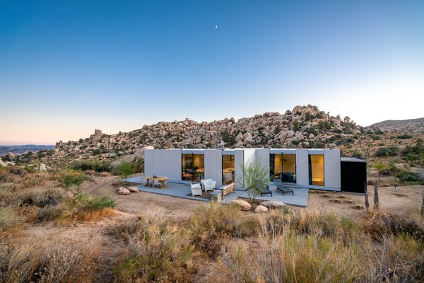 Los Angeles–based writer Leslie Longworth knew she'd found the perfect retreat when she spotted a five-acre lot in Pioneertown. Immersed in the rugged beauty of Joshua Tree with a dirt road for access, it was an ideal creative space. Seeking a low-impact build, she hired prefab company Cover to draft, construct, and install a custom home. The prefab came complete with fixtures, finishes, Wolf Sub-Zero appliances, and a state-of-the-art radiant heating and cooling system. In order to design around endangered Joshua trees, boulders, and the view, Cover used a combination of 3D mapping via drone imagery and handheld photos.