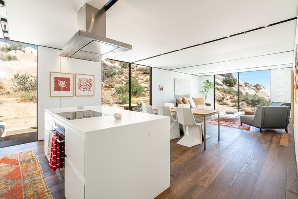 As with all Cover projects, Leslie's home features floor-to-ceiling windows, Wolf-Sub Zero appliances, integrated storage, and minimalist track lighting. The open-plan living areas are arranged axially toward views of the valley.