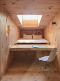 The loft space includes a raised area that can be used as a desk or a platform for a double mattress. The observation turret lets in natural light and frames views of the town to the east.