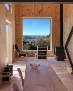 The focal point of the living room is the large southeasterly projecting window that frames views of the town, Hautapu River, and the Ruahine Range.