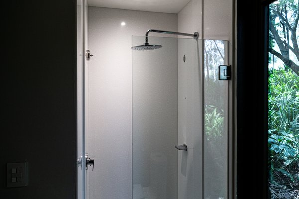 A peek inside the shower, which features Tristone solid surface walls in Snowrange.