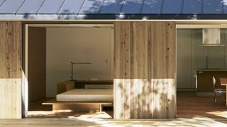 Exterior, Prefab Building Type, House Building Type, Wood Siding Material, and Metal Roof Material Japanese cedar wraps around the prefab Yō no Ie House, which is topped with a Galvalume steel roof.