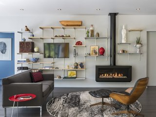 """The fireplace/bookcase wall installation takes cues from the Cado Shelving System, and also works to flatten the classic hovering fireplace into a gesture that is engaged with the wall,"" says Keating. ""Usability and modularity are both important elements of an interior that in some ways is like one big studio containing the objects of—and inspirations for—the client's artistic interests."""