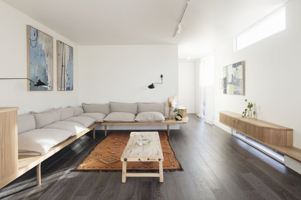 The light-filled lounge includes a 10-seat built-in sofa. The floors throughout are engineered American oak.